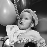 Baby blowing paper whistle, Greeting Card