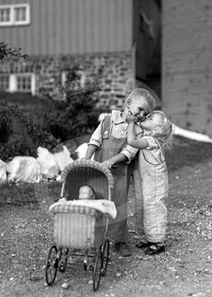 Girl kissing boy, 1930s, Greeting card
