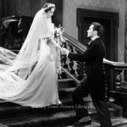 Bride on stairs on groom, Greeting card