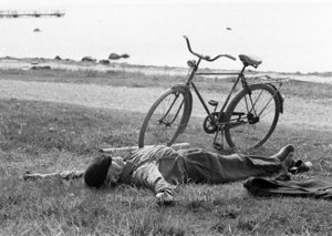 Man sleeping beside bike, Greeting card