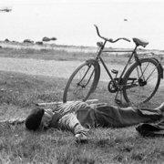 Man sleeping beside bike, Greeting card