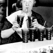 Woman drinking from two glasses, Greeting card