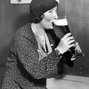 Woman drinking pint of beer, Greeting card
