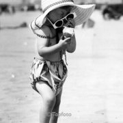 Girl on beach with big hat and sun glasses, Greeting card