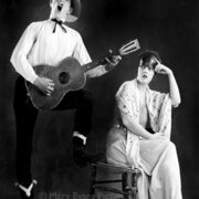 Man playing guitar with woman, Greeting card