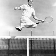 Tennis player leaping over net, Greeting card