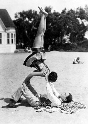 Man balancing woman, Greeting card